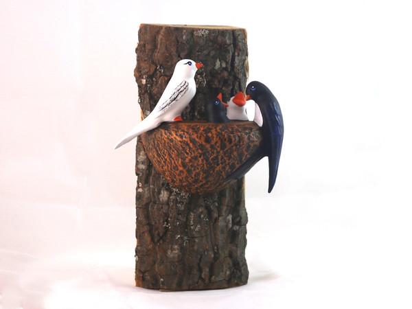 Гнездо с четири лястовици